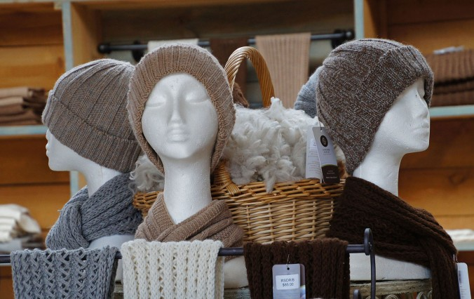 Clothing made solely from alpaca wool, available for purchase at the barn